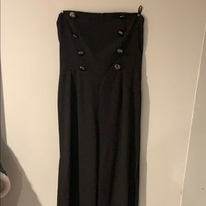 Black jumpsuit with tags still attached